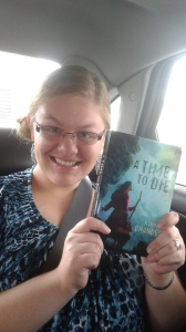 Me sitting in the car, with my new copy of a Time to Die, in complete and utter rapturous ecstasy.